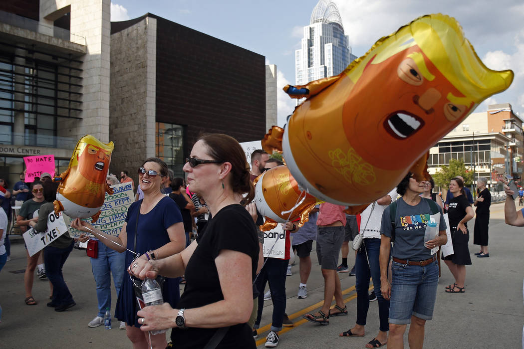 Protesters demonstrate at a campaign rally by President Donald Trump. (AP Photo/Gary Landers)