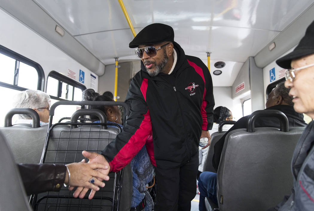 Craig Knight greets riders on a bus from the Blind Center of Nevada during an event organized b ...