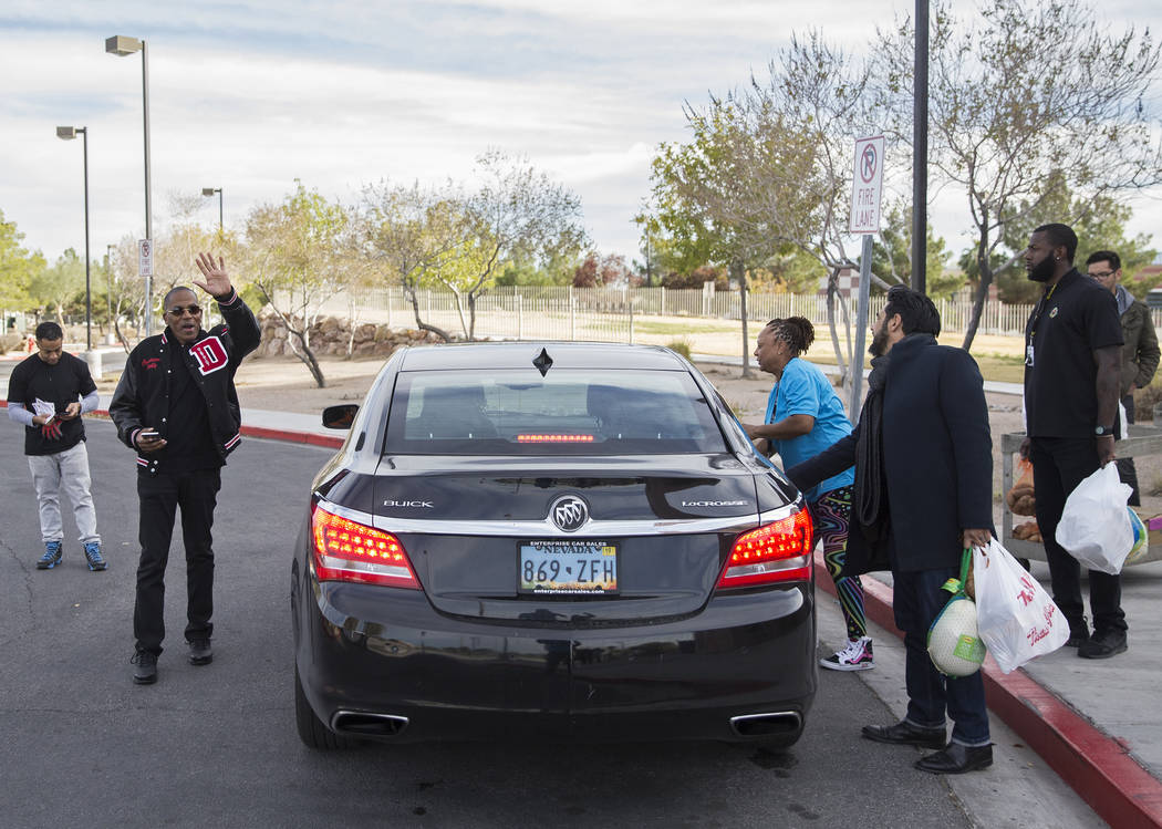 Clark County Commission Vice Chairman Lawrence Weekly, second from left, waves to friends while ...