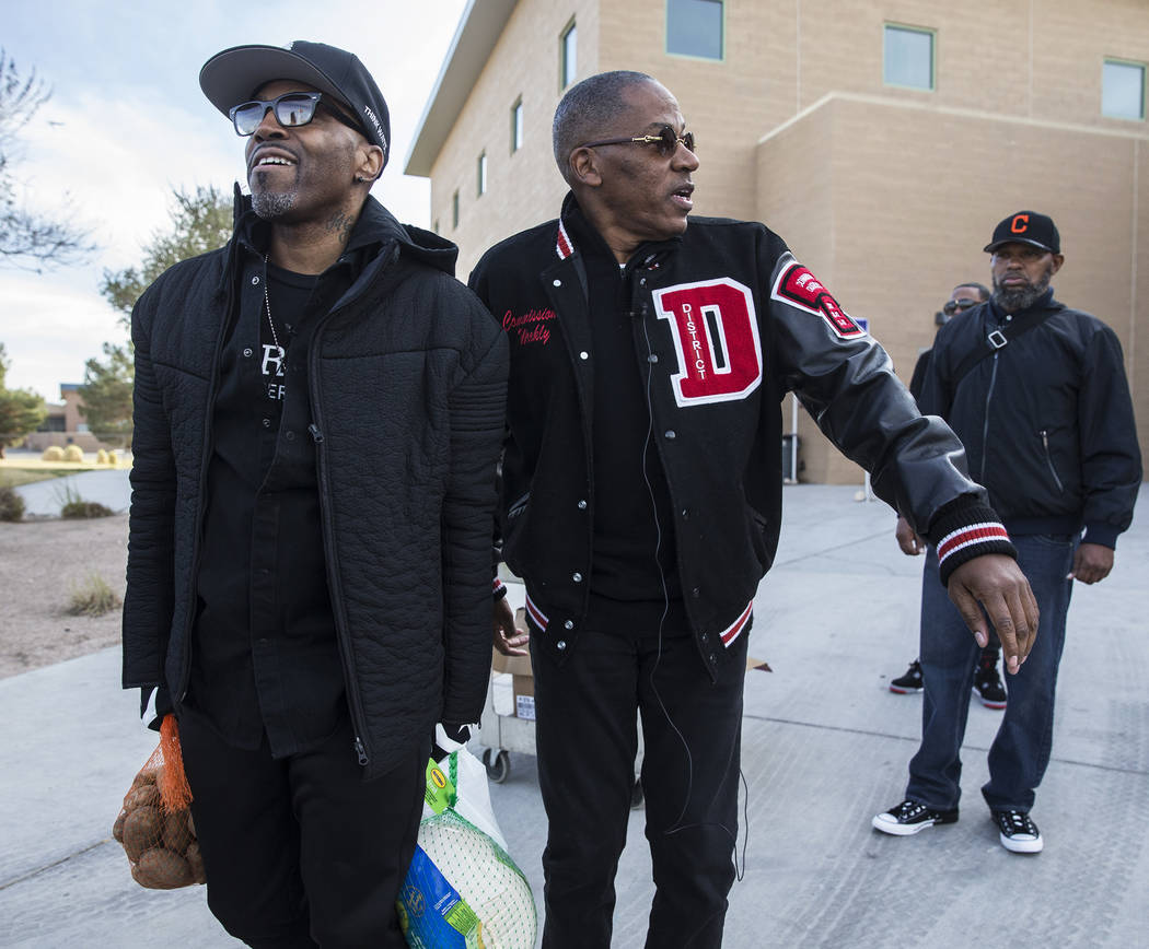 Singer/songwriter Teddy Riley, left, and Clark County Commission Vice Chairman Lawrence Weekly ...