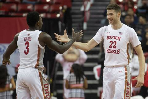 UNLV Rebels guard Amauri Hardy (3) celebrates with UNLV Rebels forward Vitaliy Shibel (22) afte ...