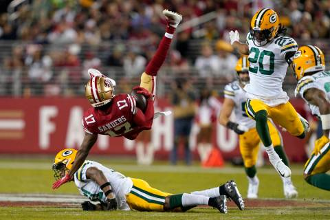 San Francisco 49ers wide receiver Emmanuel Sanders (17) falls backward over Green Bay Packers s ...