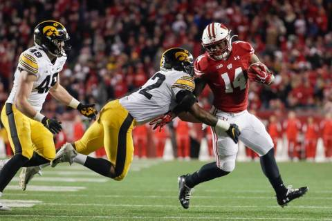 Wisconsin's Nakia Watson tries to get past Iowa's Djimon Colbert during the second half of an N ...