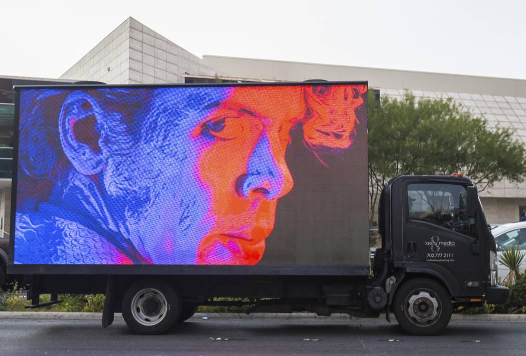A mobile billboard truck drives on the Strip at on Saturday, Nov. 30, 2019, in Las Vegas. (Benj ...