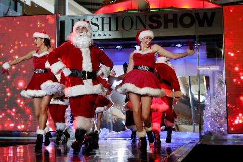 Performers in the Holiday Glow at Fashion Show mall in Las Vegas Friday, Nov. 29, 2019. The hol ...