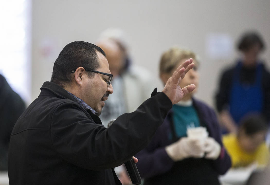 Pastor Fernando Anguiano prays before the start of the Las Vegas Rescue Mission's annual Thanks ...