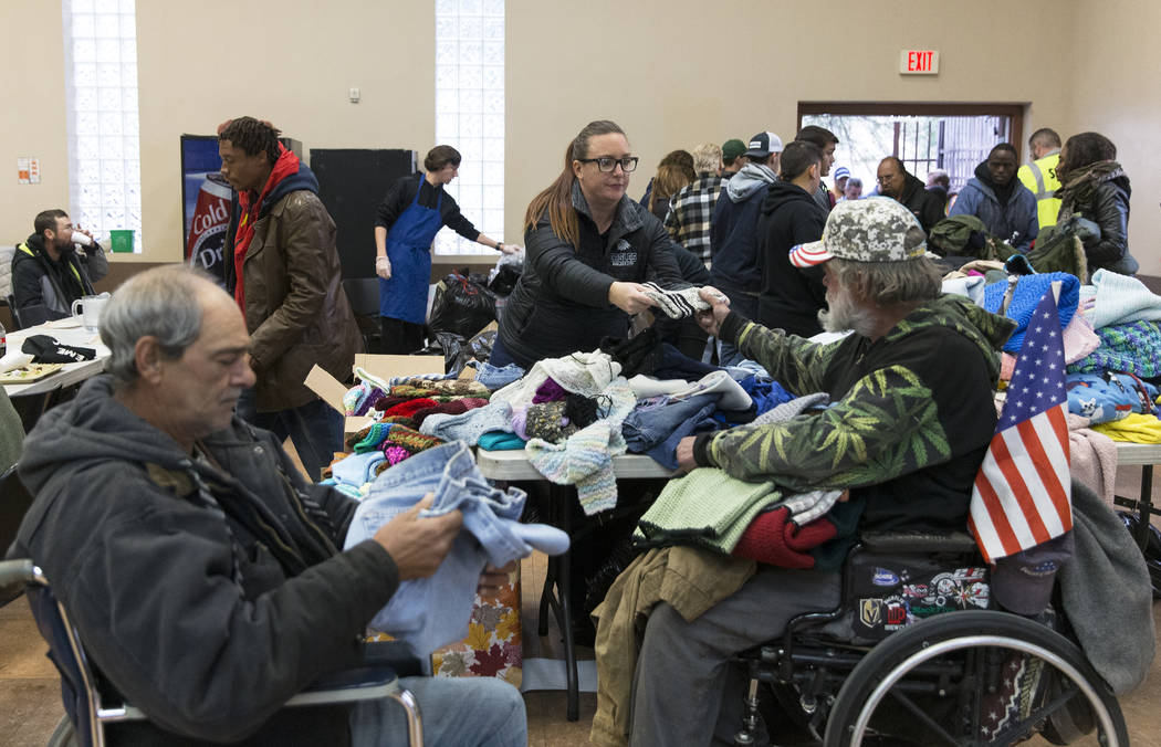 Tami Leavitt, top/right, with Blazes Wish, hands out blankets during the Las Vegas Rescue Missi ...