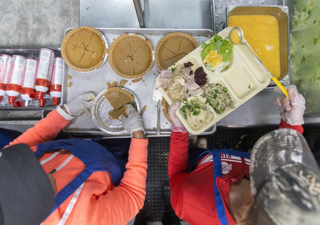 Volunteers Jamie Almasi, right, and Edna Sanders prepare trays of food during the Las Vegas Res ...