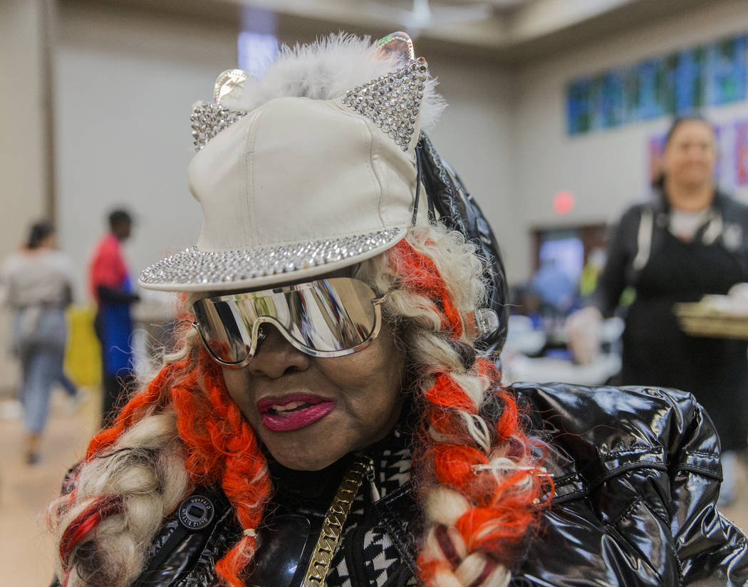 Missy Morgan gets ready to eat during the Las Vegas Rescue Mission's annual Thanksgiving meal o ...