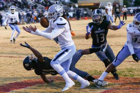 Centennial's Nate Conger (9) intercepts the ball in front of Desert Pines' Jett Solomon (11) du ...