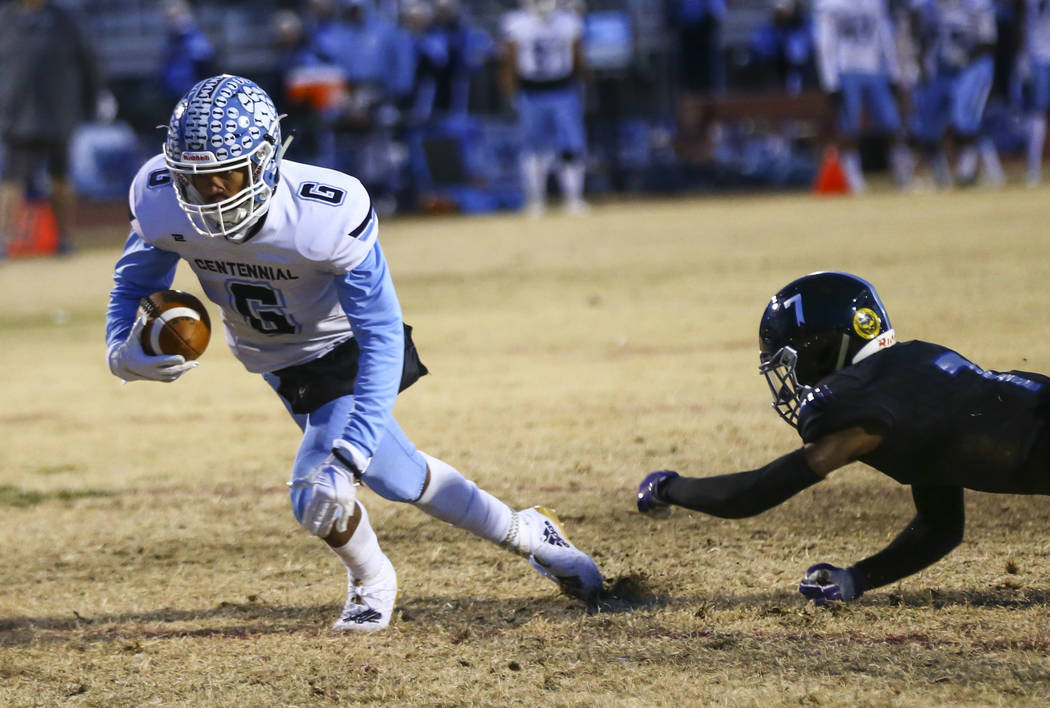 Centennial's Gerick Robinson (6) gets to the end zone to score a touchdown past Desert Pines' D ...