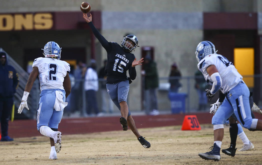 Desert Pines' Rjay Tagataese (15) throws a pass during the first half of a Class 4A football st ...