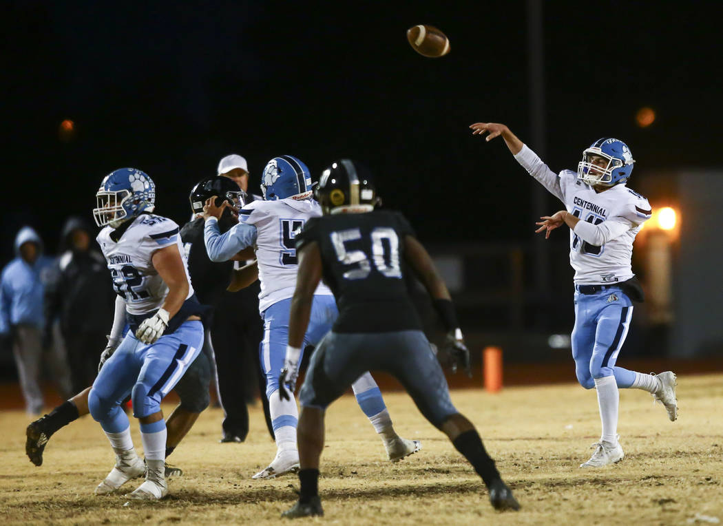 Centennial's Colton Tenney (10) throws a pass during the first half of a Class 4A football stat ...