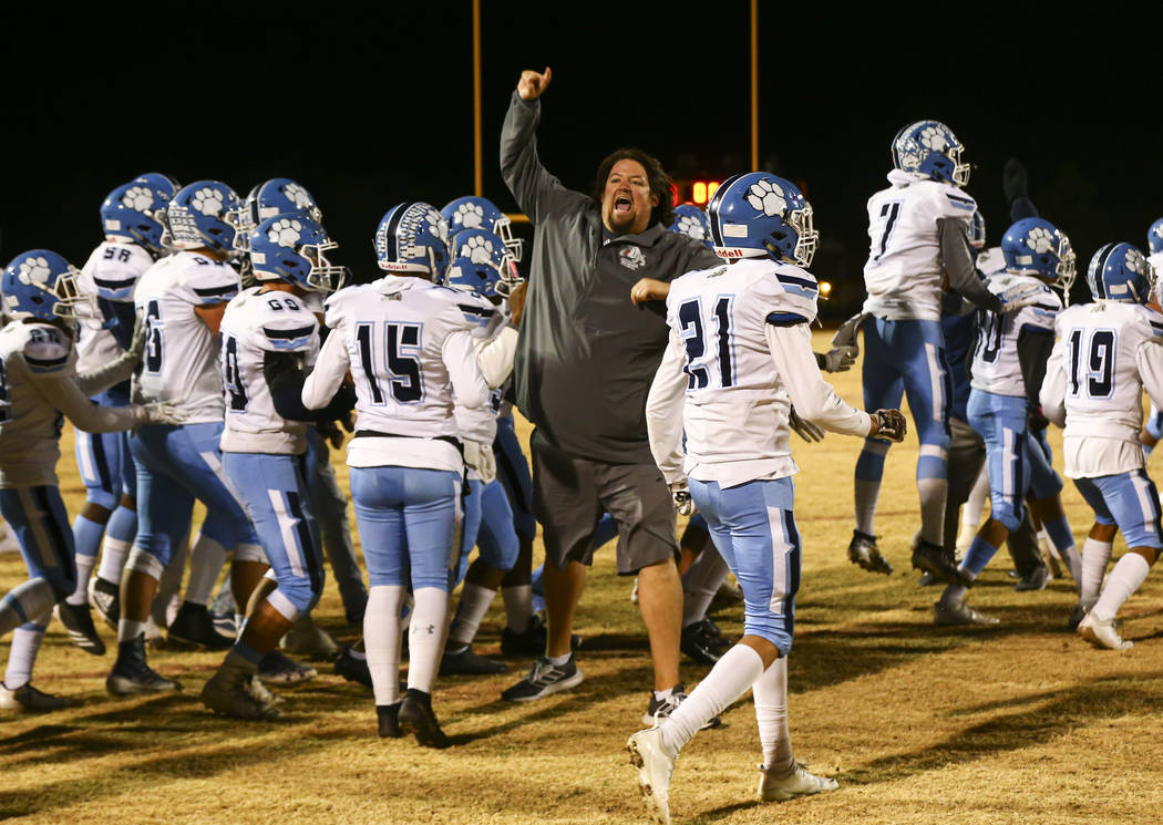 Centennial head coach Dustin Forshee celebrates after his team's 20-7 win over Desert Pines in ...