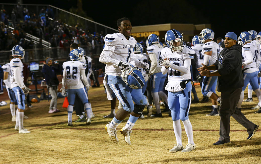 Centennial's Jordan Smith (1) celebrates after his team's 20-7 win over Desert Pines in a Class ...