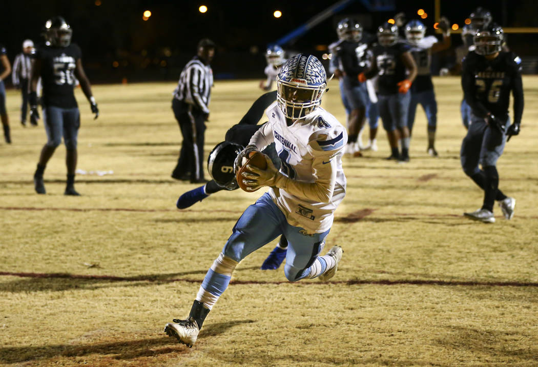 Centennial's Aaron Johnson (4) scores a touchdown against Desert Pines during the second half o ...