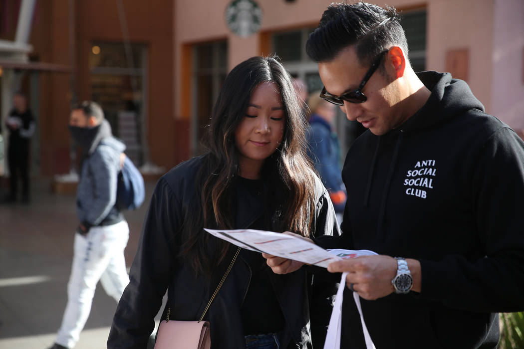 Jamie Lee, left, and her husband Gregory, of Los Angeles, shop at the Las Vegas North Premium O ...
