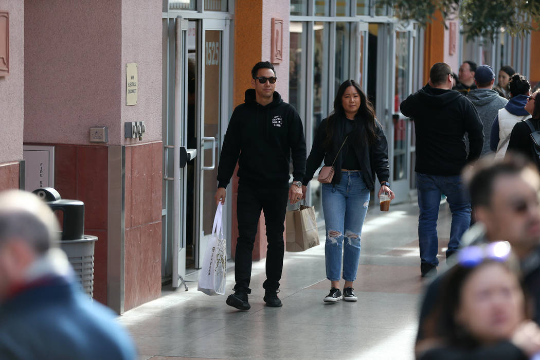 Gregory Lee, left, and his wife Jamie, of Los Angeles, shop at the Las Vegas North Premium Outl ...