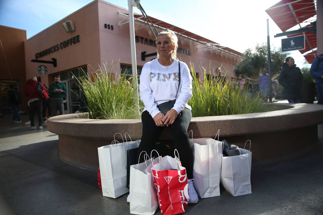 Evie Manning of the United Kingdom takes a break from shopping at the Las Vegas North Premium O ...