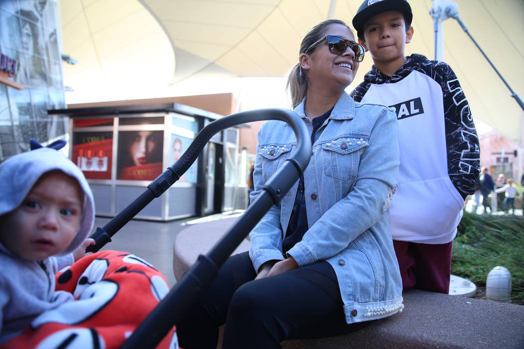 Juanita Ramirez, center, with her sons Bryan, 10, and Jameson, 1, of Las Vegas, shop at the Las ...