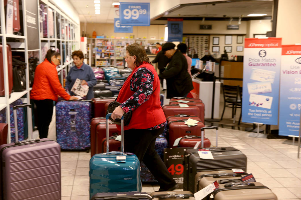 People shop at JCPenny at Meadows Mall in Las Vegas for early Black Friday deals on Thanksgivi ...