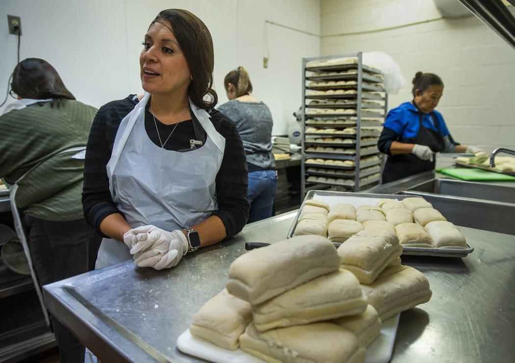 Volunteer Selva Montoya helps to prepare loaves of bread as Catholic Charities of Southern Neva ...