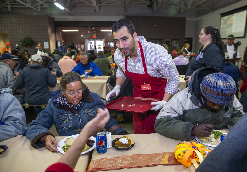 Former U.S. Rep. Ruben Kihuen, D-Nev., delivers another meal as Catholic Charities of Southern ...