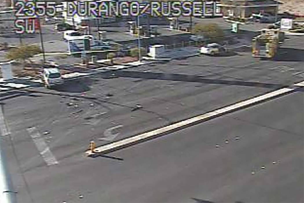 Las Vegas police investigate a fatal crash at South Durango Drive and West Russell Road in the ...