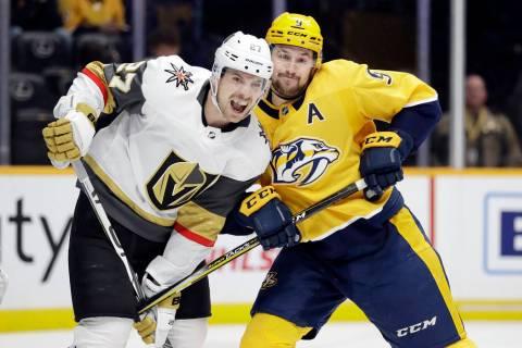 Nashville Predators left wing Filip Forsberg (9) battles against Vegas Golden Knights defensema ...