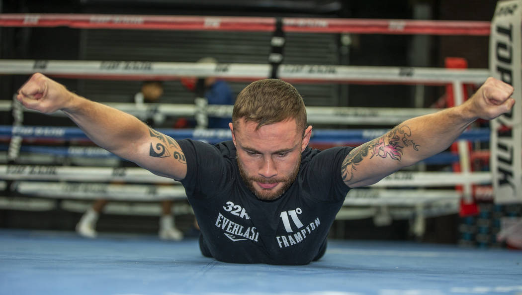 Former two-weight world boxing champion Carl Frampton works his core at the Top Rank Gym, Tuesd ...