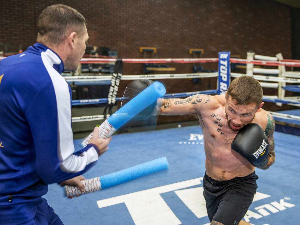 Former two-weight world boxing champion Carl Frampton, right, boxes with trainer Jamie Moore at ...