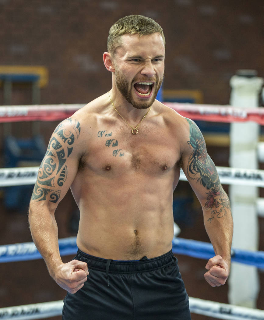Former two-weight world boxing champion Carl Frampton is pumped up during a training at the Top ...