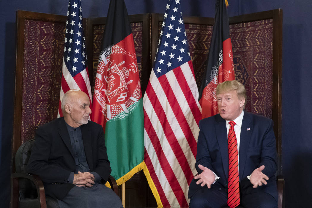 President Donald Trump speaks during a meeting with Afghan President Ashraf Ghani during a surp ...