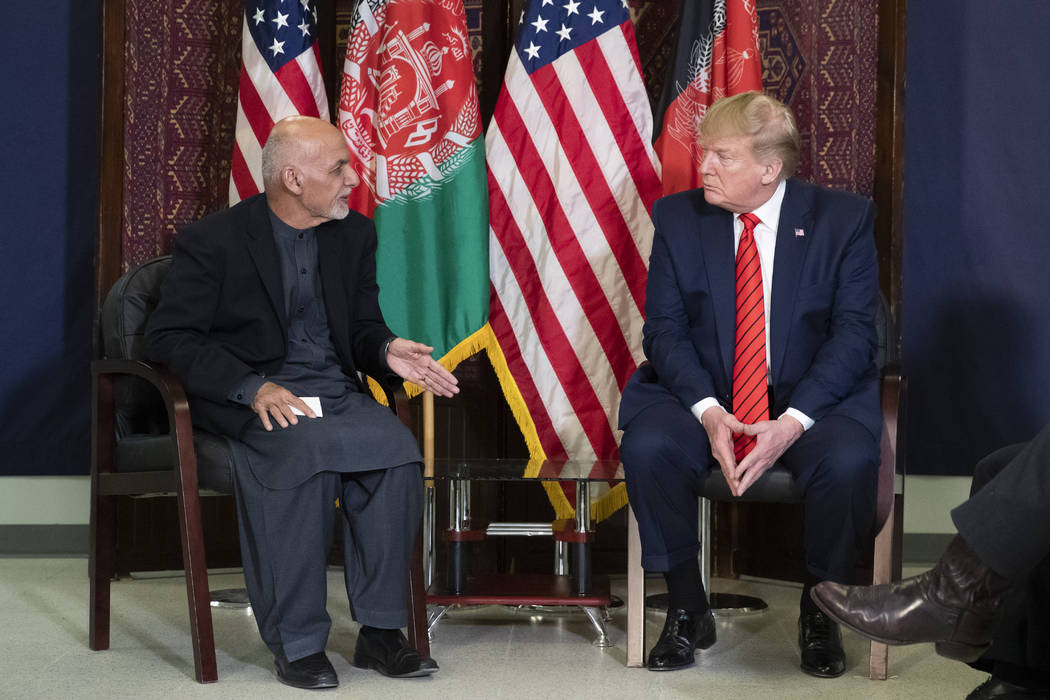 President Donald Trump listens during a meeting with Afghan President Ashraf Ghani during a sur ...