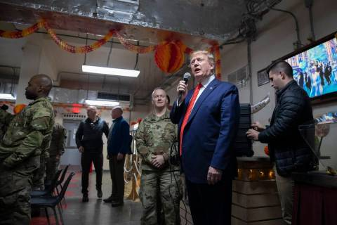 President Donald Trump speaks at a dinning facility during a surprise Thanksgiving Day visit to ...