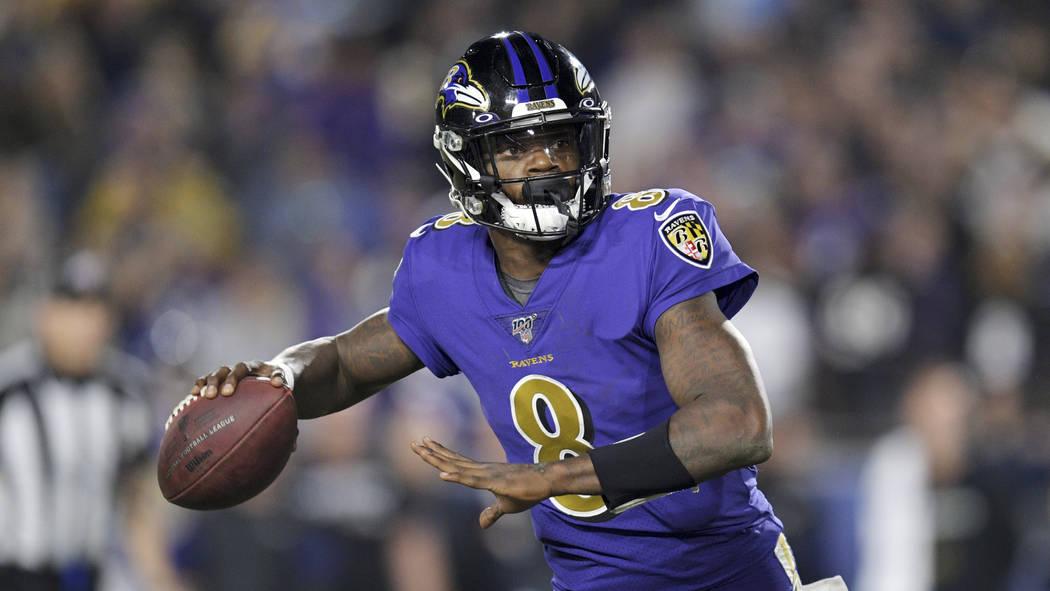Baltimore Ravens quarterback Lamar Jackson passes against the Los Angeles Rams during the secon ...