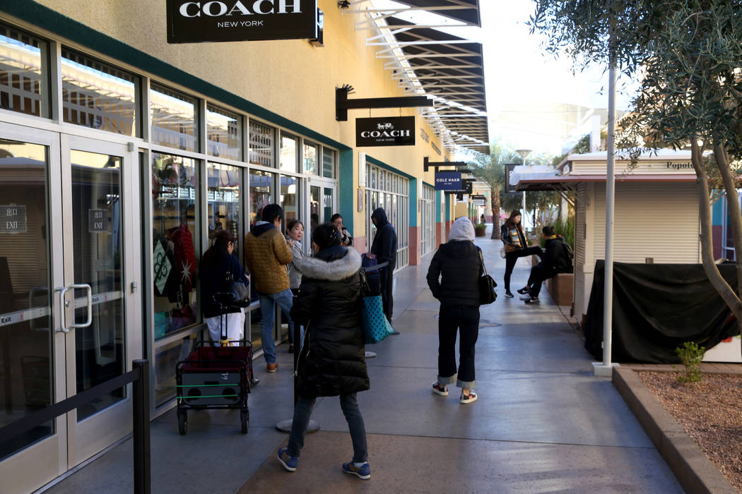 People line up at the Coach store at Las Vegas North Premium Outlets before opening on Thanksgi ...