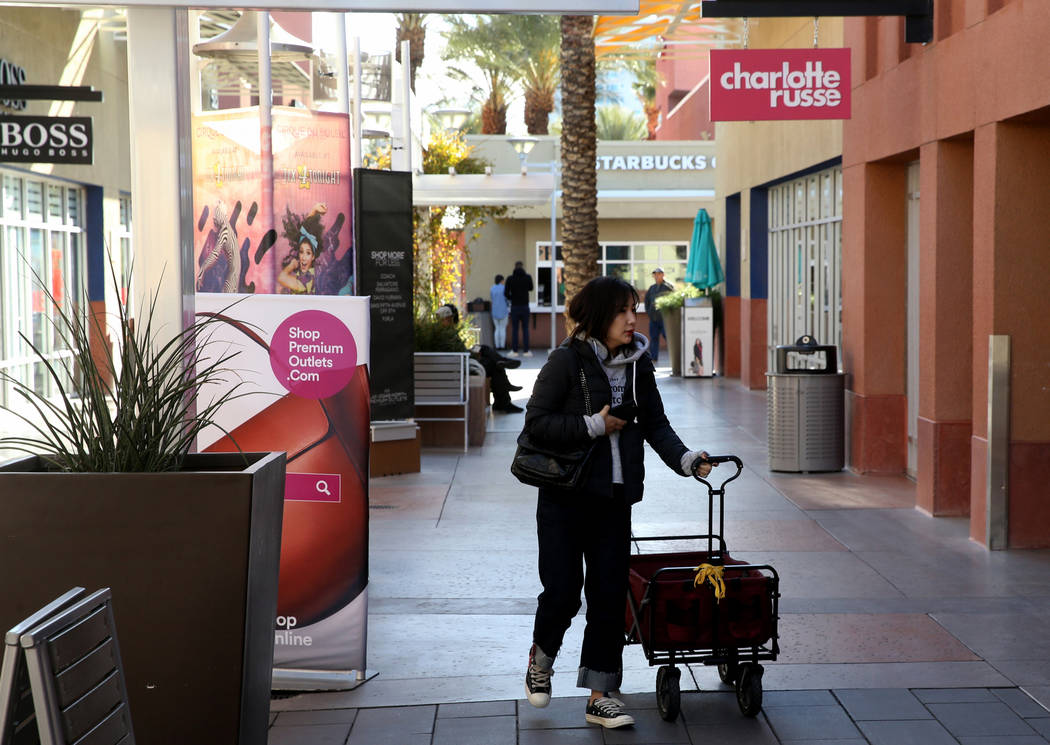 Rachel Xu of Los Angeles prepares her wagon before opening at Las Vegas North Premium Outlets o ...