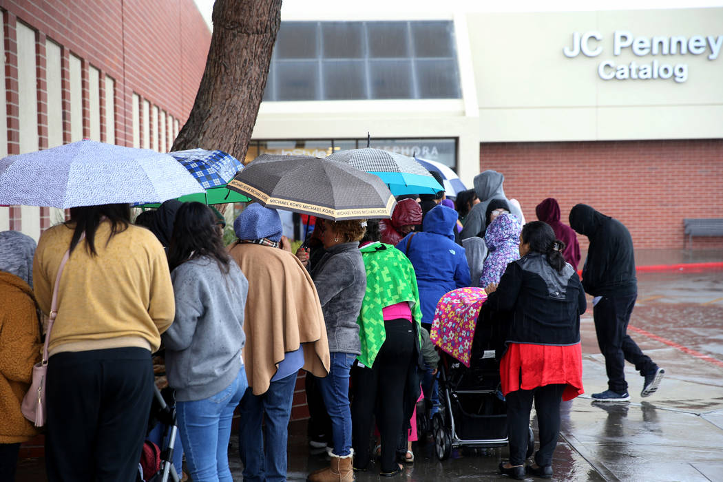 People line up to enter JCPenney at Meadows Mall in Las Vegas for early Black Friday deals on T ...