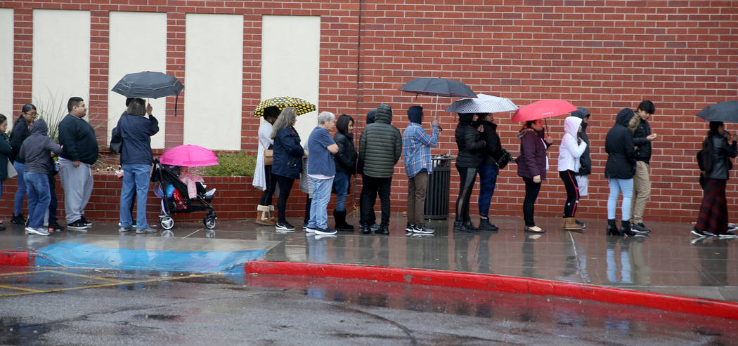 People line up to enter JCPenny at Meadows Mall in Las Vegas for early Black Friday deals on Th ...