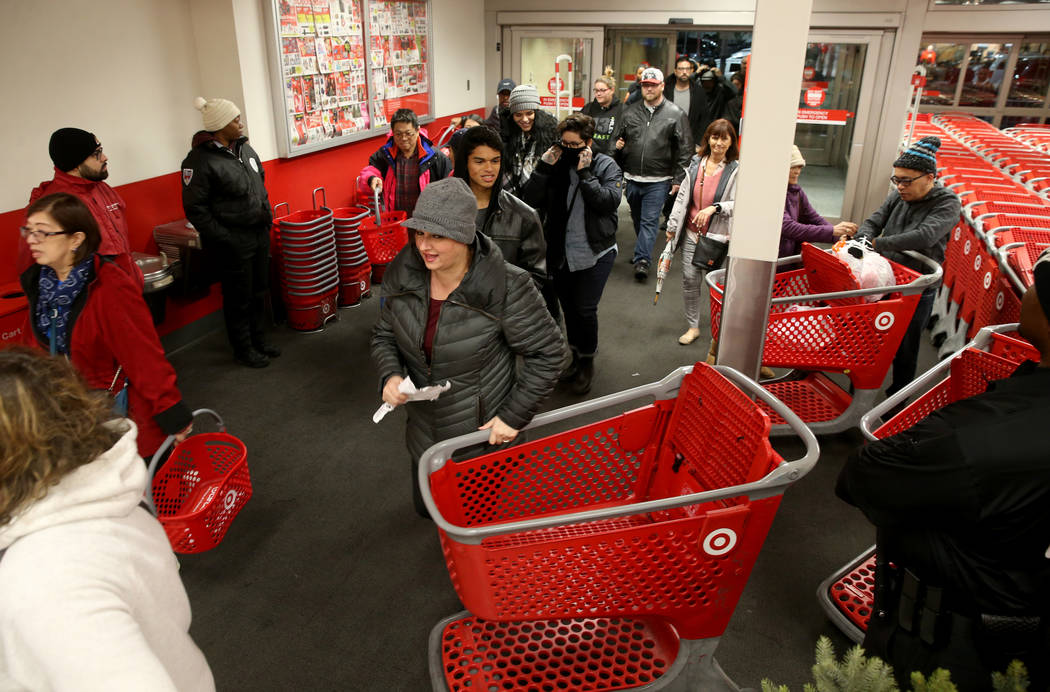 Shoppers file in for the 6 p.m. opening of Target at Maryland Parkway and Flamingo Road for ear ...
