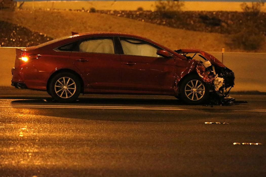 A damaged car is seen after a fatal crash on U.S. Highway 95 near Lake Mead Boulevard, Thursday ...