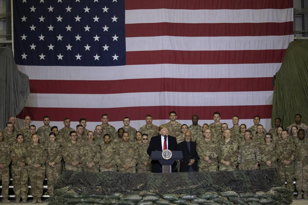 President Donald Trump addresses members of the military during a surprise Thanksgiving Day vis ...