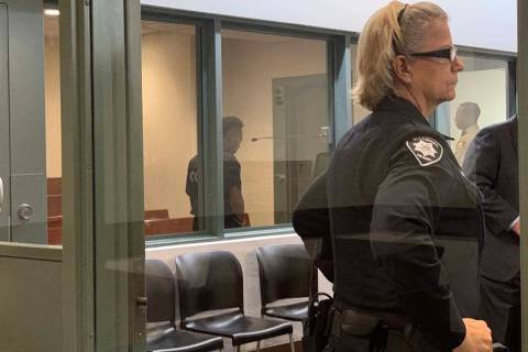 Nathaniel Tavers Postelle III, behind the windows, was in court Friday afternoon, Nov. 29, 2019 ...