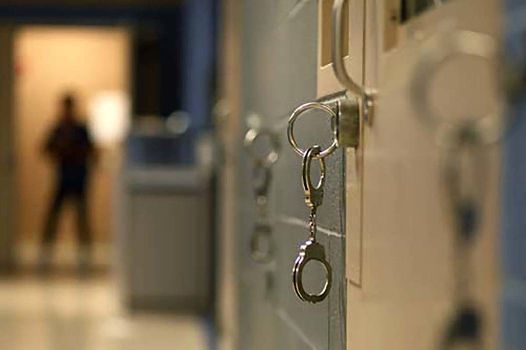 Handcuffs hang from the wall in the North Las Vegas jail in North Las Vegas Thursday, Aug. 23, ...