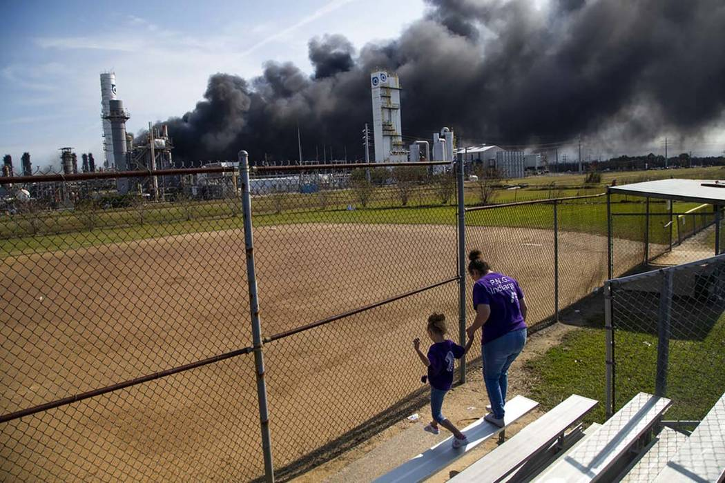 Cloud of smoke in the background from the TPC Group Port Neches Operations explosion is visible ...