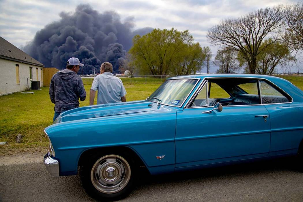 Ray Moore and Milton Perio observe the fire consuming TPC Group plant on Wednesday, Nov. 27, 20 ...