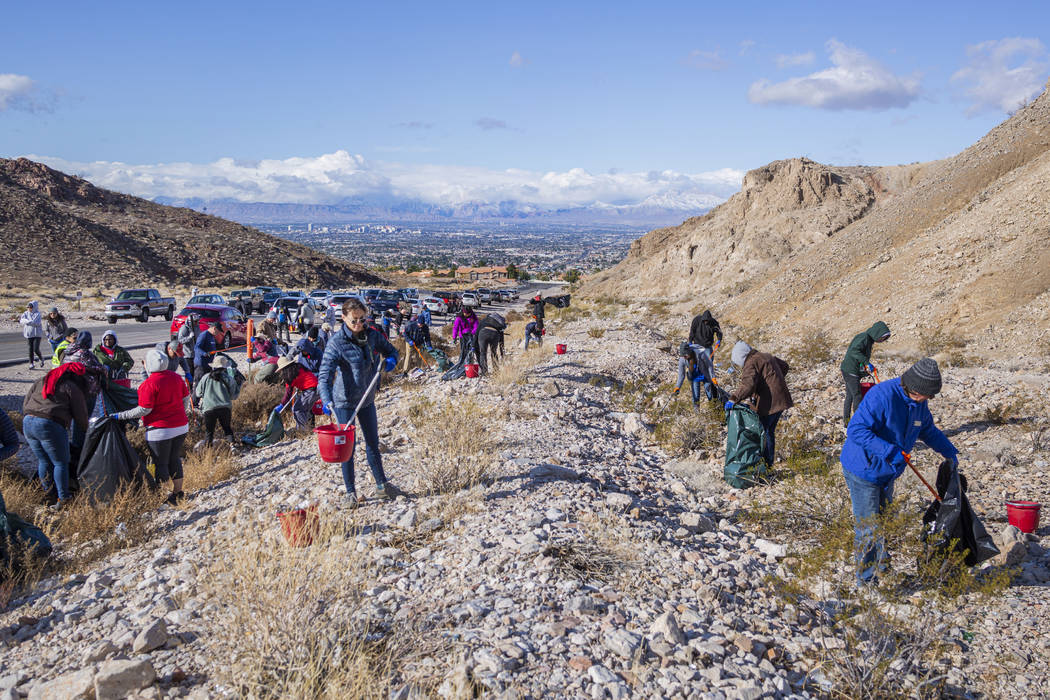 Volunteers for Get Outdoors Nevada clean up garbage near the trail leading to the Great Unconfo ...