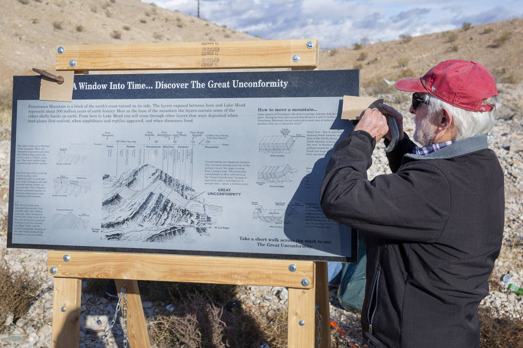 UNLV Geology Professor Steve Rowland sets up a granite sign explaining the history of the Great ...