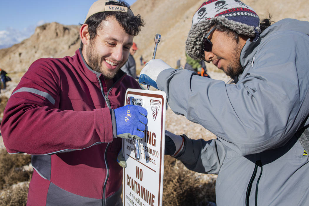 Volunteers for Get Outdoors Nevada Dillon Battaglia, left, of Paradise, Calif., and Carlos Ojit ...